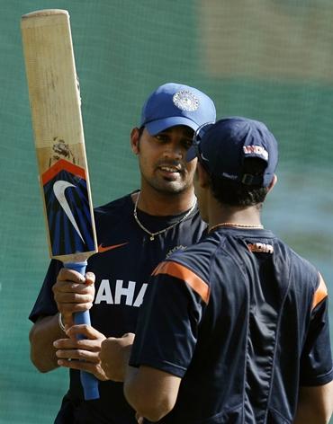Murali Vijay and Ravindra Jadeja chat during practice on Friday
