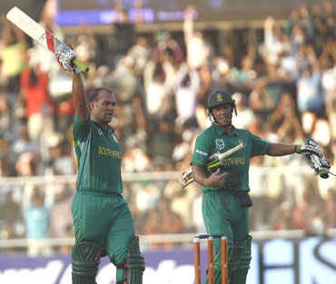 Kallis and AB De Villiers celebrate after scoring centuries