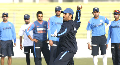 Indian skipper Mahendra Singh Dhoni is involved in fielding drills at a training session in Dhaka