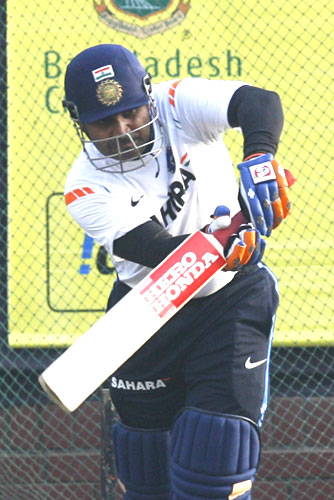 Virender Sehwag bats in the nets during a practice session in Dhaka
