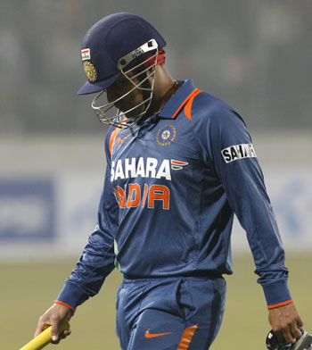 Virender Sehwag walks back to the pavilion