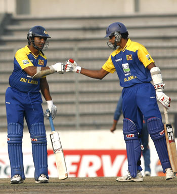 Suraj Randiv (right) congratulates Sangakkara, after the latter scored a half century