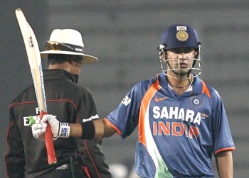 Gautam Gambhir acknowledges the crowd after scoring a half century