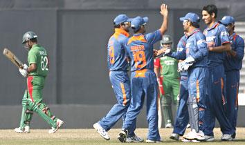 Sudeep Tyagi is congratulated after dismissing Bangladesh opener Imrul Kayes