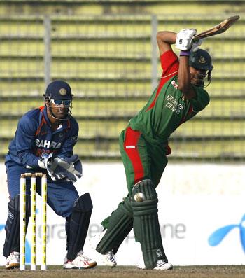 Bangladesh's captain Shakib Al Hasan hits one down the ground