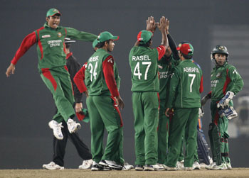 Bangladesh players celebrate fall of Indian wicket