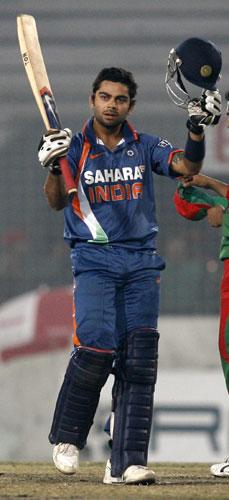 Virat Kohli reacts after reaching century