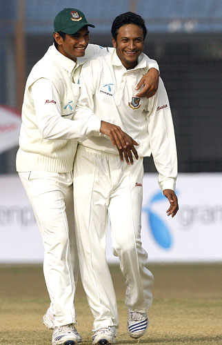 Bangladesh's Mahmudullah (left) congratulates captain Shakib Al Hasan after picking a wicket