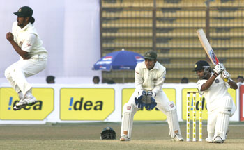 India's Amit Mishra (right) plays a shot as Bangladesh's Shahriar Nafees (left) takes evasive action