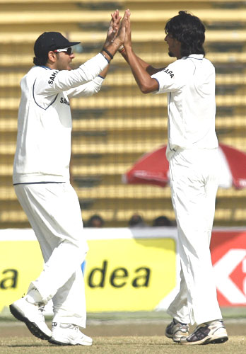 Yuvraj Singh (left) congratulates Ishant Sharma after dismissing Bangladesh's Shakib Al Hasan