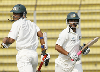 Bangladesh's Junaid Siddique and Tamim Iqbal run between the wickets during their partnership.