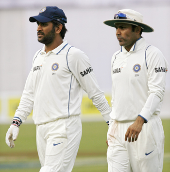 India's captain MS Dhoni and Virender Sehwag come off the field after the third day's play