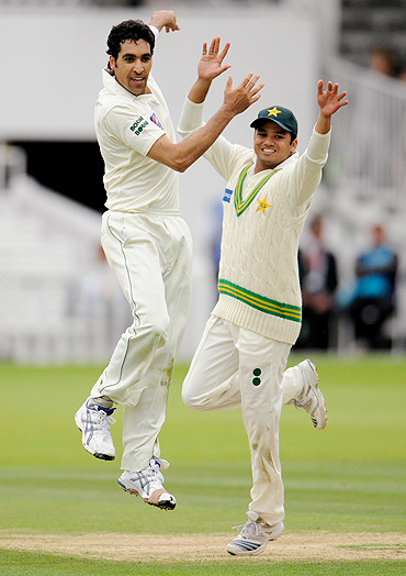 Umar Gul (left) celebrates with Azhar Ali after dismissing Austalia's Tim Paine