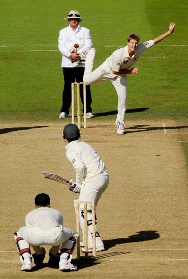Australia's Steven Smith bowls to Pakistan's Salman Butt during the first Test match at Lord's