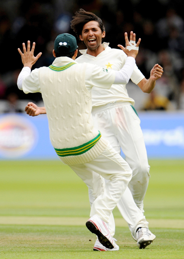 Mohammad Asif celebrates after picking up a wicket