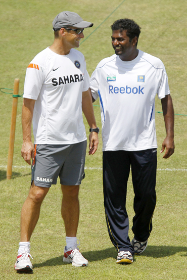 India's coach Gary Kirsten shares a laugh with Sri Lanka's Muttaih Muralitharan during a practice session in Galle
