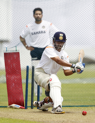 Gautam Gambhir plays a sweep shot during a practice session