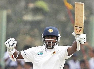 Rangana Herath celebrates after reaching his half-century