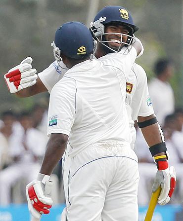 Lasith Malinga celebrates after reaching his half-century