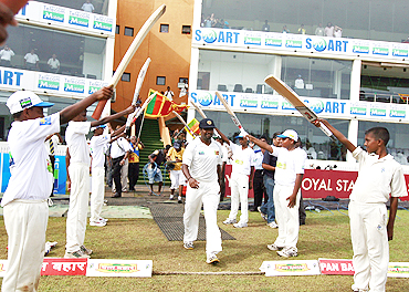 Muttiah Muralitharan walks onto the field before the start of the Indian innings on Tuesday