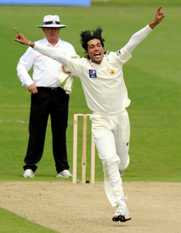 Mohammad Aamer celebrates after picking up a wicket