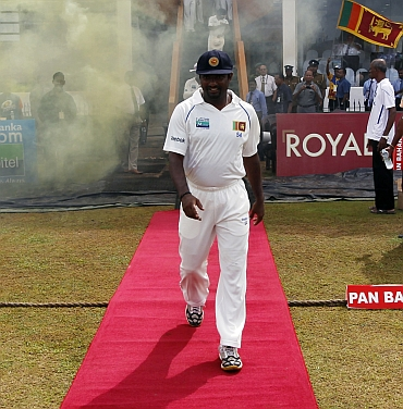Muttiah Muralitharan walks on to the field during the fifth day of the first Test
