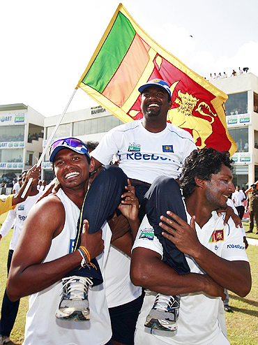 Muttiah Muralitharan is lifted by his teammates after Sri Lanka's victory over India in the first Test on Thursday
