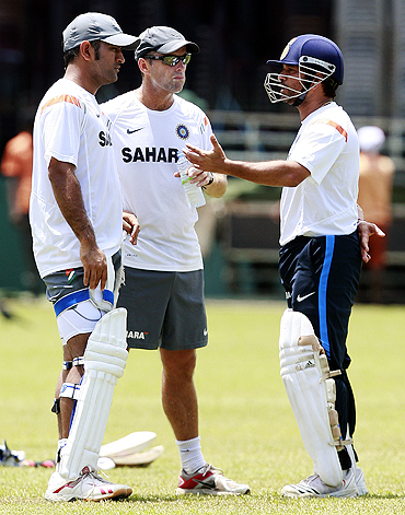 India's captain Mahendra Singh Dhoni, coach Gary Kirsten (centre) and Sachin Tendulkar talk during a practice session in Colombo on Sunday
