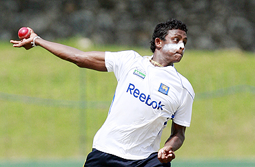 Sri Lanka's Ajantha Mendis bowls in the nets during a practice session in Colombo on Sunday