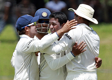 Pragyan Ojha celebrates after picking up Dilshan