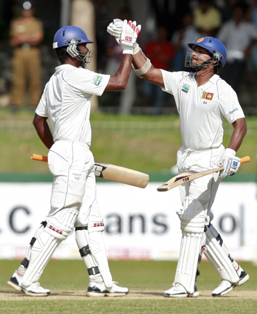 Paranavitana and Sangakkara celebrate after reaching centuries
