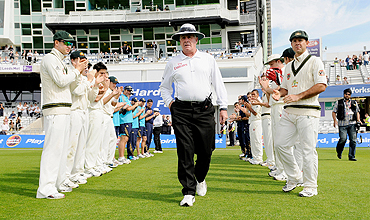 The Australian squad form a guard of honour for umpire Rudi Koertzen (centre) before the fourth day of the second cricket Test at Headingley Carnegie cricket ground in Leeds on Saturday