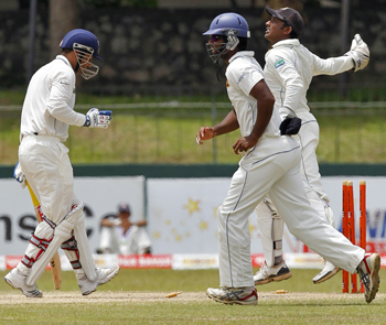 Sri Lanka's wicketkeeper Jayawardene celebrates after stumping Sehwag