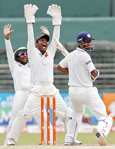 Mahela Jayawardene (left) and wicketkeeper Prasanna Jayawardene (centre) appeal unsuccessfully for the wicket of Ojha