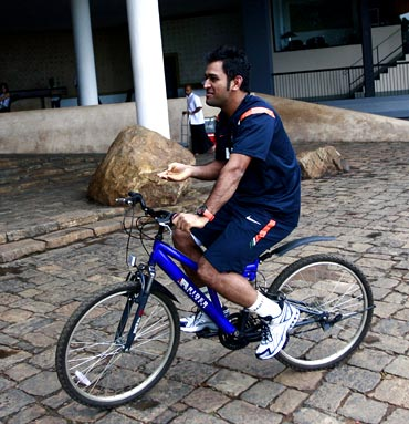 Mahendra Singh Dhoni rides a bicycle in Dambula