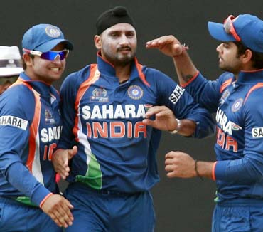 Harbhajan Singh is jubilant after taking the wicket of Bangladesh's captain Shakib Al Hasan