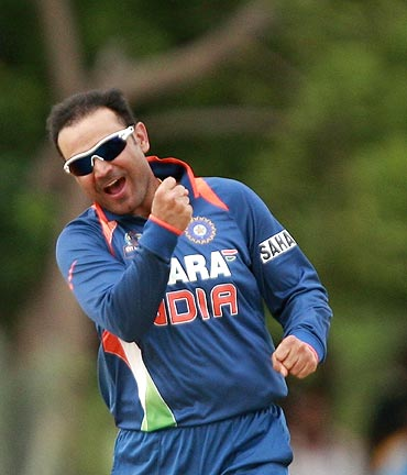 Virender Sehwag celebrates taking the wicket of Mushfiqur Rahim