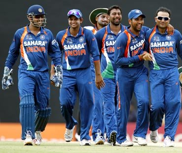Indian team walk back at the end of the innings
