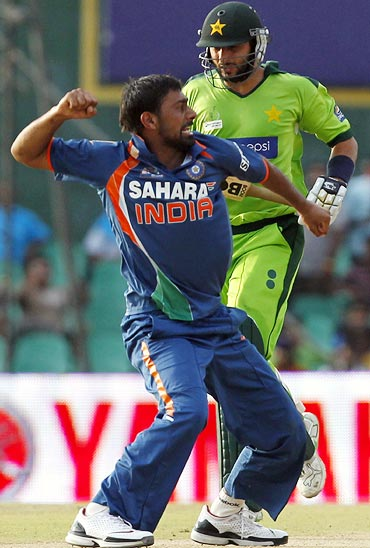 Praveen Kumar celebrates after taking the wicket of Shahid Afridi