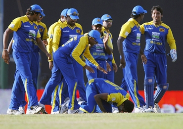 Maharoof kisses the ground after claiming the hat-trick wicket