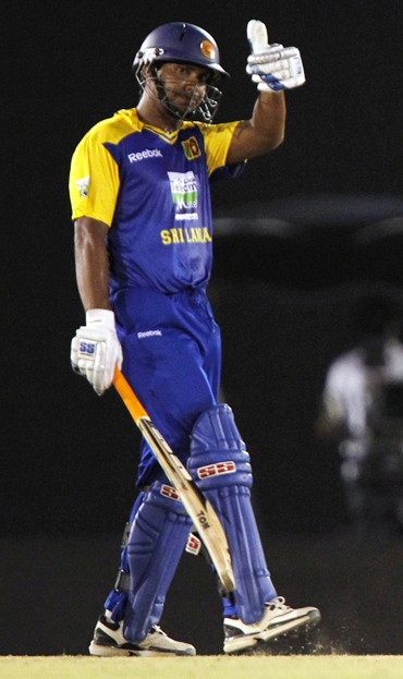 Sri Lanka's captain Kumar Sangakkara waves to the crowd after completing fifty