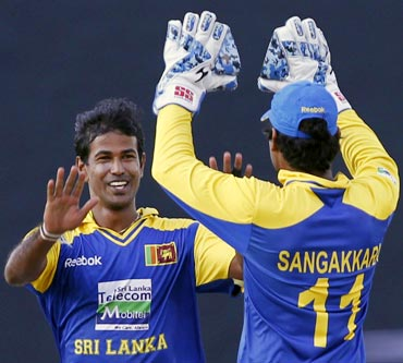 Nuwan Kulasekara (left) and Kumar Sangakkara celebrate the wicket of Rohit Sharma