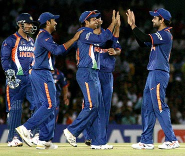 Indian players celebrate after the dismissal of Thilina Kandamby