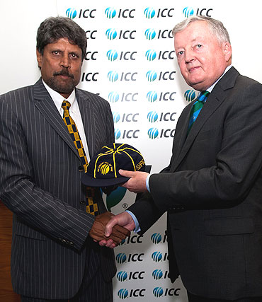 ICC President David Morgan (right) presents Kapil Dev with his commemorative cap during his induction into the ICC Cricket Hall of Fame at the ICC headquarters in Dubai