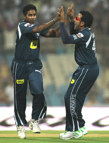 Chaminda Vaas (left) celebrates with Rohit Sharma