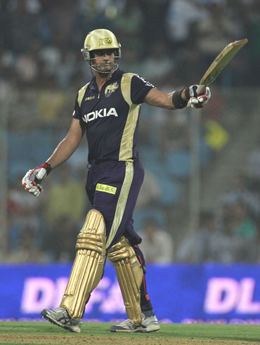 Owais Shah celebrates after reaching his half-century