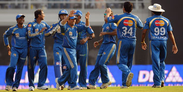 Mumbai Indians players celebrate after Asnodkar's run out