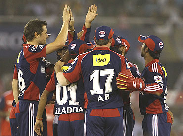 The Delhi Daredevils players celebrate after picking the wicket of Swapnil Asnodkar