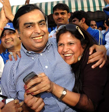 Mumbai Indians owner Mukesh Ambani with a relative