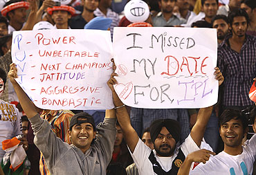 Fans cheer during the match between Kings XI Punjab and the Delhi Daredevils